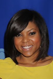 Taraji rocked her signature bob which was parted on the side with her bangs swept softly across her face.