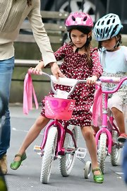 Katie Holmes dressed Suri in a beautiful print dress, then added just a hint of color with green mary-jane flats.