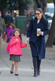 Suri Cruise was all smiles in this bright pink jacket with matching backpack.