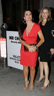 Kyle Richards wore this red cocktail dress while out with Paris Hilton.