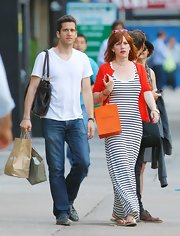 Molly Ringwald showed off her curvy figure in a black-and-white striped maxi dress.