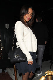 Sanaa Lathan carried a drool worthy Lanvin Happy Sac bag. Although the purse would truly go well with anything, it looked particularly fab with a filmy chiffon dress and white blazer.