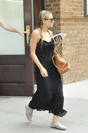 Ashley Olsen left her New York hotel in comfort wearing a pair of casual nude slip-on shoes.
