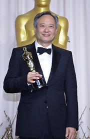 Ang Lee donned a classic black bow tie for his 2013 Oscars win.