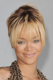 Rihanna completed her barely-there makeup look with a shiny soft beige lipstick for the 2012 BRIT Awards.