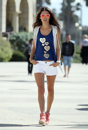 Alessandra Ambrosio looked sporty and cool in these white short shorts, which she sported for a Victoria's Secret photo shoot in LA.