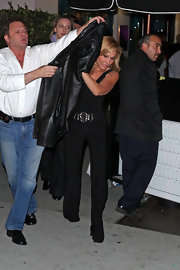 Adrienne Maloof went for a sexy retro look with this sleeveless black jumpsuit during a dinner date.