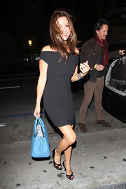 """What seemed to be a bit of a wind storm down in LA, Burke braves the cold in her black mini dress. She carried one of the hottest handbags among celebs, the """"Birkin"""" bag."""