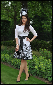 Aishwarya wore a soft white and black lace dress to the Royal Ascot's Opening Day.