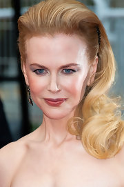 Nicole Kidman showed off her lovely strawberry blonde locks with a wavy 'do that she teased and pinned up on the sides for extra height.