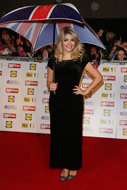 Holly Willoughby chose this figure-hugging black gown with a jeweled neckline for her red carpet look at the Pride of Britain Awards.
