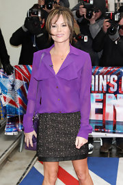 Amanda Holden looked sassy in a sheer purple blouse at the London Palladium for 'Britain's Got Talent' auditions.