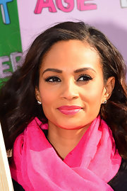 Alesha Dixon rocked a pink scarf and matching pink lips while protesting domestic violence.