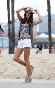 Alessandra Ambrosio opted for white short shorts for her beachy look while on a Victoria's Secret photo shoot.