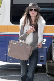 Alessandra looked oh-so-posh in this thick fur vest and Birkin bag.