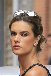 Alessandra stuck to a messy bun for her laid back look.