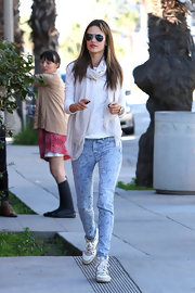 Light-wash jeans with a funky design give Alessandra Ambrosio a playful feeling while taking a walk with her family.