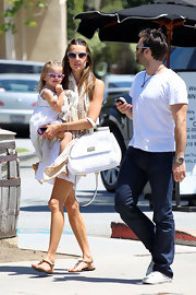 Alessandra Ambrosio kept her street style summery with a white crochet Miss Sicily tote.
