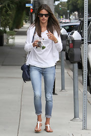Alessandra Ambrosio chose a classic white blazer to dress up her pair of striped skinny jeans.