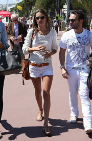 Alessandra Ambrosio looked stunning in all white when she wore this loose knit crocheted top and cutoff shorts.