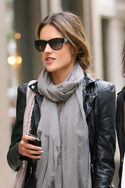 The stunning supermodel dressed down for a day out with her girls and sported a black pair of designer shades.