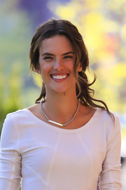 Alessandra Ambrosio's long brown waves looked casual and cool when pulled back into a loose ponytail.