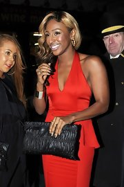 Alexandra Burke opted for a black ruched clutch for her night out after the Brit Awards.