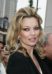 Kate Moss showed off her medium curls while hitting the TopShop launch party.