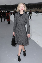 Rosamund wore this classic winter coat to the Dior couture show in Paris.