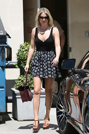 Ali Larter looked ready for a day in the sun when she opted for this black tank and printed mini.