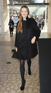 Petra Nemcova beat the icy chill in NYC in a large black high collar coat.