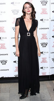 Amy Acker chose a flowing black gown that featured a deep  V-neck and an embellished buckle belt.