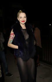 Looking very glam-rock in her plush fur vest, Porcelain Black happily posed for the paparazzi at a music party in LA.