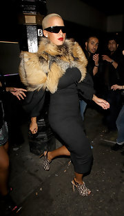 Amber Rose paired her fur coat with blacked out designer shades.