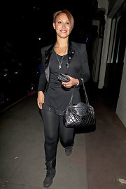 Sugababes front girl Amelle Berrabah struts her stuff while taking a stroll down a London neighborhood.