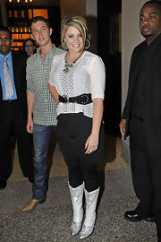 Lauren Alaina stayed true to her country roots in a pair of girly white cowboy boots.
