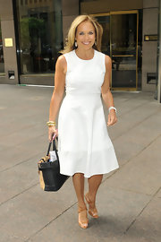 Katie Couric looked summery and chic in this white sleeveless A-line.