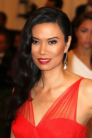 Wendi Deng swept her wavy locks on the right to show a little of her neck and shoulders at the Costume Institute Benefit Gala.