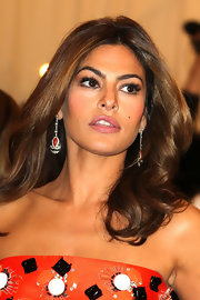 Eva Mendes arrived at the Met Gala wearing art deco coral onyx and diamond pendant earrings set in platinum.