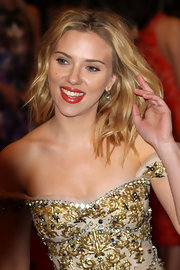 Scarlett Johansson wore a glimmering pair of antique cushion cut diamond drop earrings to the Costume Institute Gala.