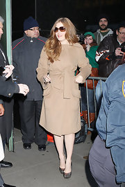 Amy donned a classic camel coat for her appearance on 'Good Morning America.'
