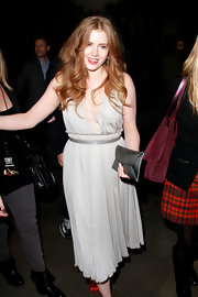 Amy Adams matched her floaty chiffon dress to a pewter envelope clutch.