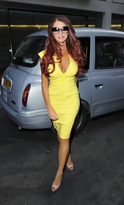 Amy Childa showed off her curves with a deep V-neck, fitted-yellow dress.