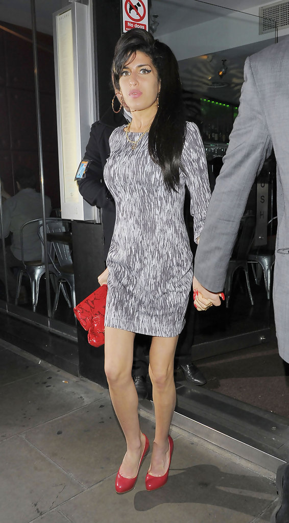 Amy Paired Her Printed Mini Dress With Red Accessories Including A Pair Of Platform Pumps Winehouse