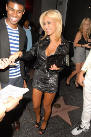 Shauna Sand went out for a night of clubbing carrying a quilted black purse.