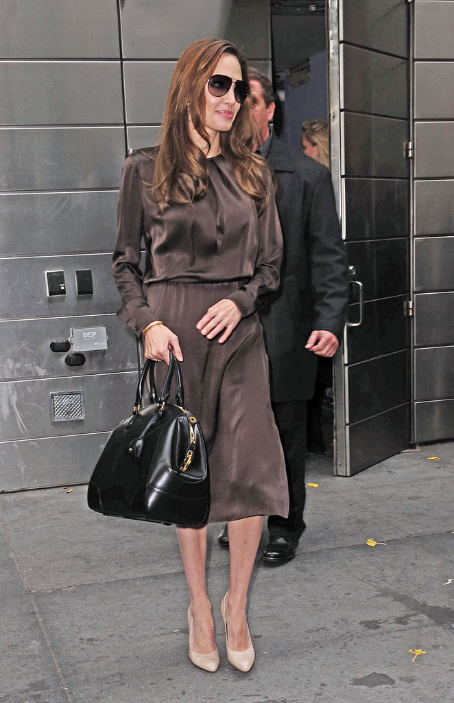 Angelina Jolie Gave Her Sumptuous Chocolate Satin Dress A Luxe Finish With Black Leather Bedford Bowler Bag