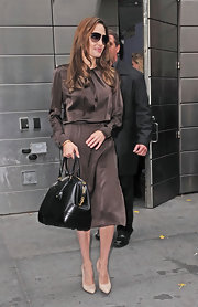 Angelina Jolie gave her sumptuous chocolate satin dress a luxe finish with a black leather Bedford bag.