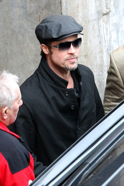 Brad is donning his gray shades and gray hat for this cool look in Budapest.