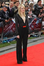 Emma Stone really knows how to rock a jumpsuit. Check out this beaded number at the 'Spider-Man' premiere in London.