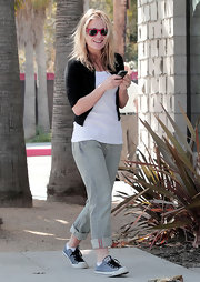 "The laid back actress sported a pair of blue ""Chuck Taylors"" with black laces and a pair of striped denim pants. These are the ultimate California cool footwear."